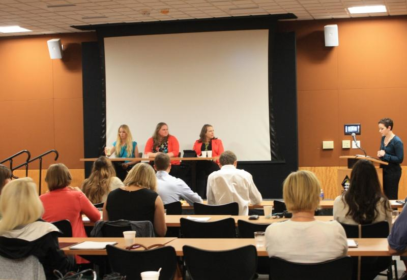 Panel speaking at a conference