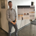 Cody Rusher with research poster