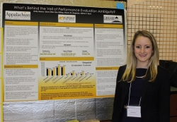 Woman presenting a research poster